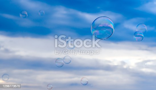 a lot of soap bubbles against the background of the patchy sn to. High quality photo