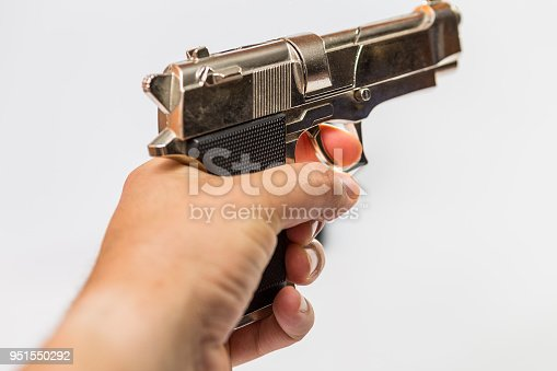 istock a male hand holds a toy gun that resembles a fighting weapon. 951550292
