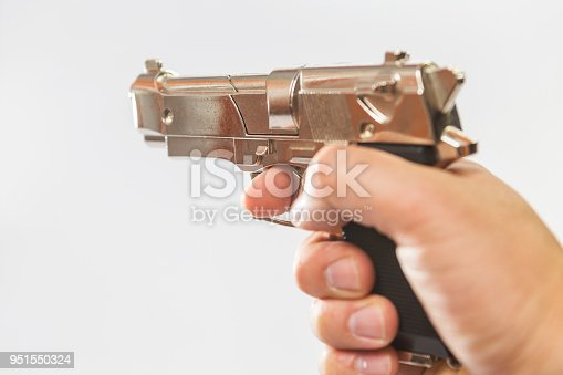 istock a male hand holds a toy gun that resembles a fighting weapon. 951550324