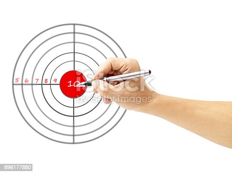 935757718 istock photo a male's hand holding pen pointing to the bull's eye of a target 696177880