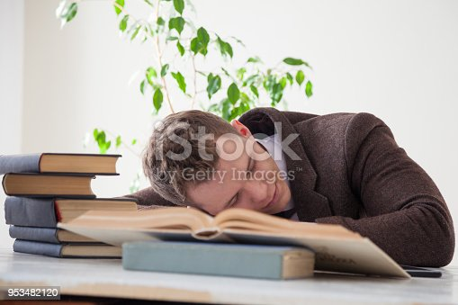 istock a man in a business suit fell asleep at a desk 953482120