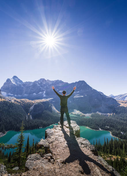 a man on the mountain top stock photo