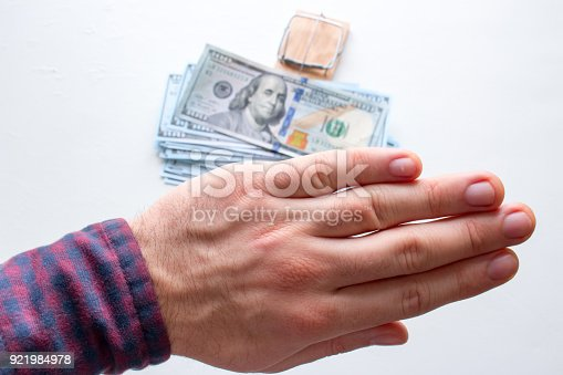 848170878istockphoto a man refuses a bribe close-up. the concept of the fight against corruption 921984978