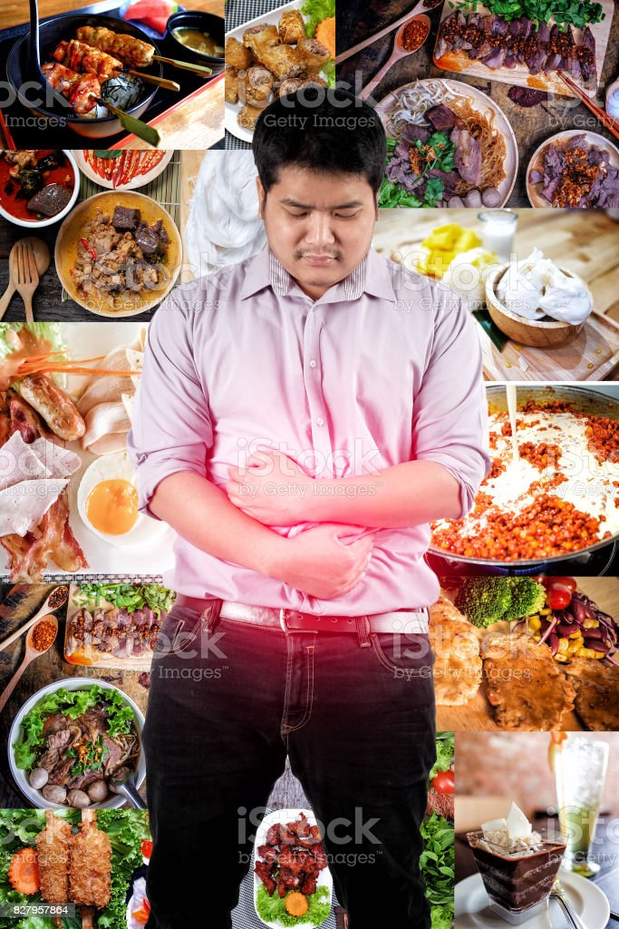 a man suffering from stomach ache because of eating too much food stock photo