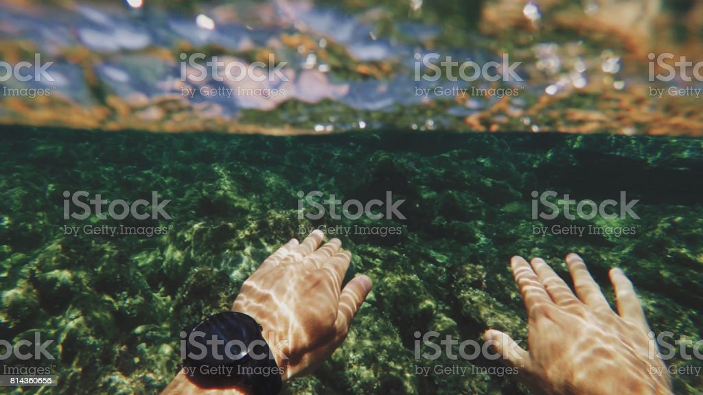 POV of a man swimming and snorkeling in a summer sea stock photo