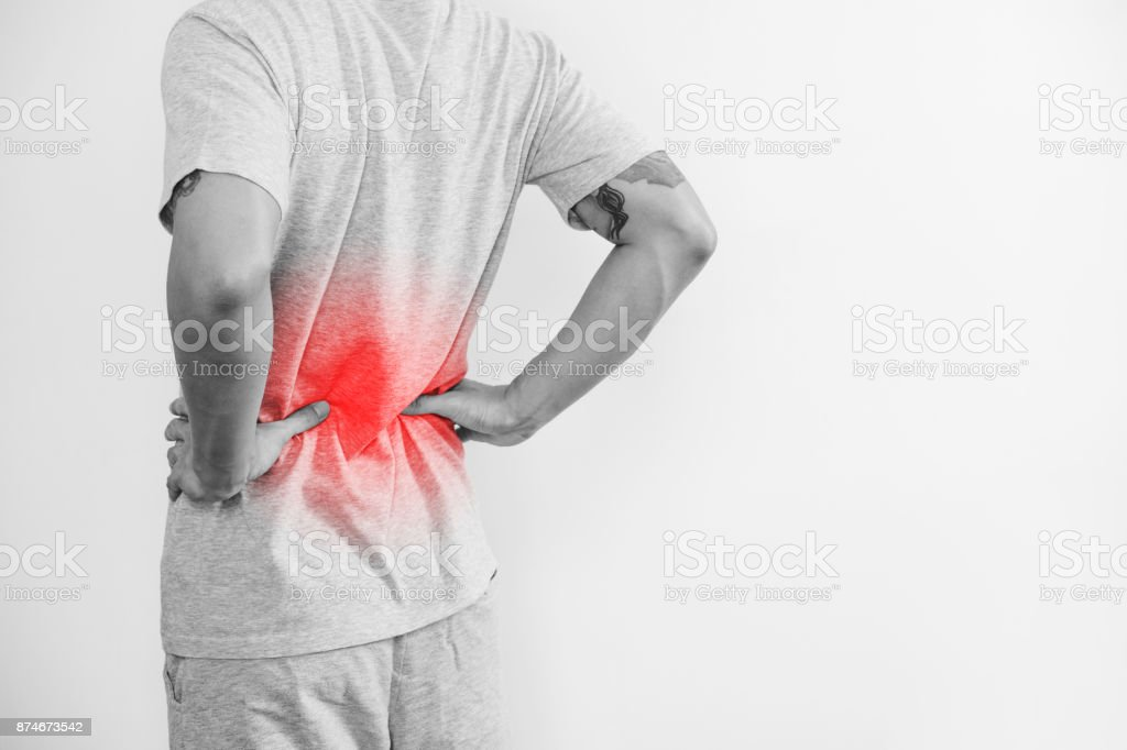 a man touching his back, with red highlight. Back pain, backache and waist pain, on white background with copy space stock photo