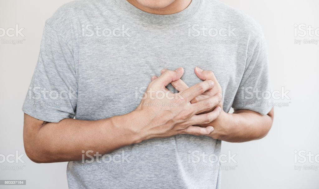 a man touching his heart. Heart attack, and others heart disease concept stock photo
