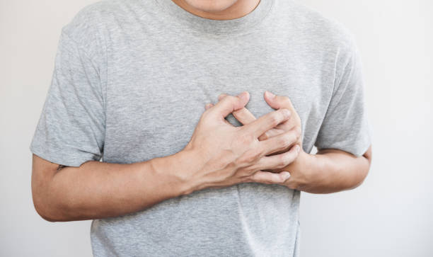 a man touching his heart. heart attack, and others heart disease concept - cardiovascular system stock pictures, royalty-free photos & images
