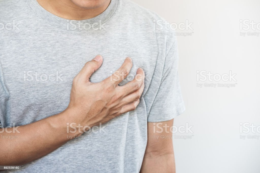 a man touching his heart. Heart attack, heart failure, others heart disease stock photo