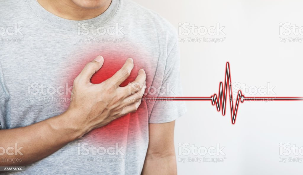 a man touching his heart, with heart pulse sign. Heart attack, and others heart disease stock photo