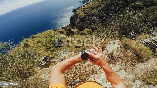 POV of a Man trail running offroad in a mountain forest