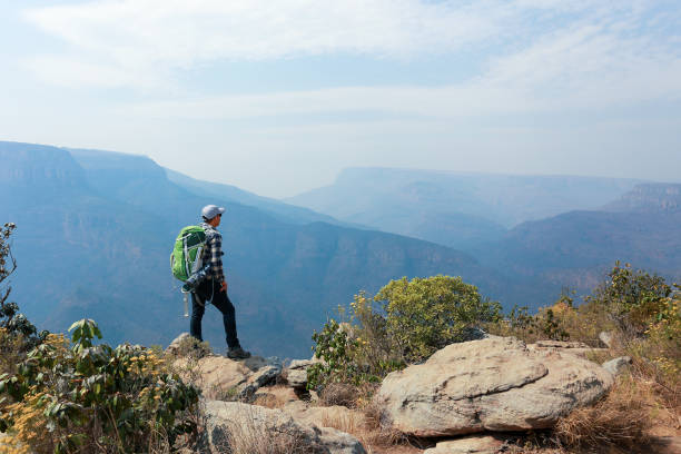a man traveler with panorama view in bylde river canyon, South Africa stock photo