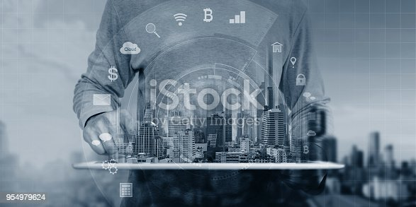 istock a man using digital tablet and interface online application icons 954979624