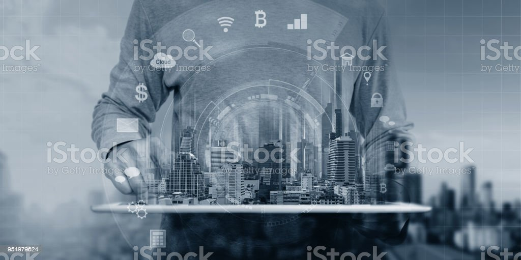 a man using digital tablet and interface online application icons stock photo