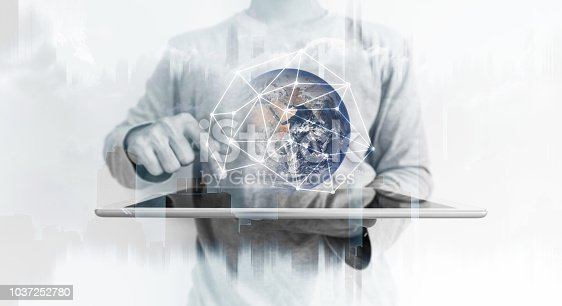 696632698istockphoto a man using digital tablet with global network connection technology hologram. Element of this image are furnished by NASA 1037252780