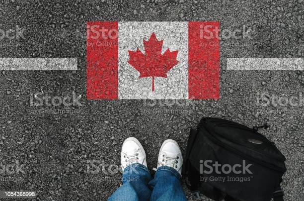 A man with a shoes is standing next to flag of canada picture id1054368998?b=1&k=6&m=1054368998&s=612x612&h=a6snbjo vswwn aysgg6uhwl4bagxbmxfe9n119ft2i=