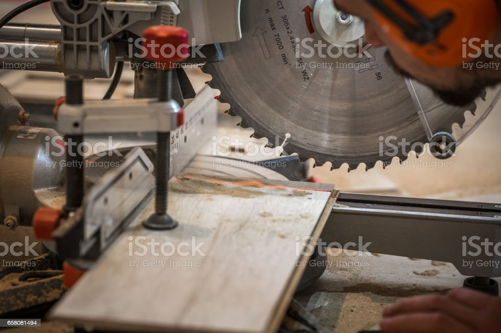 a man working with electric saw royalty-free stock photo
