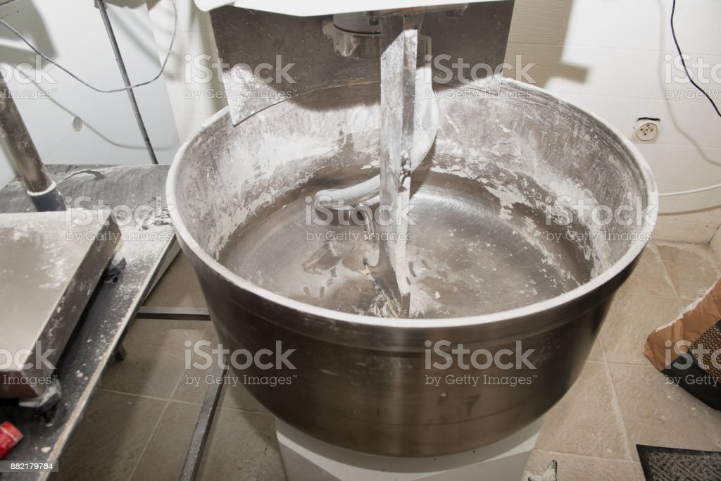a mixer for kneading the bread  in bakehouse stock photo