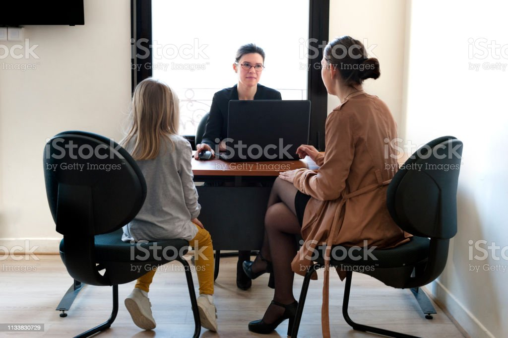a mother and daughter in school talk royalty-free stock photo