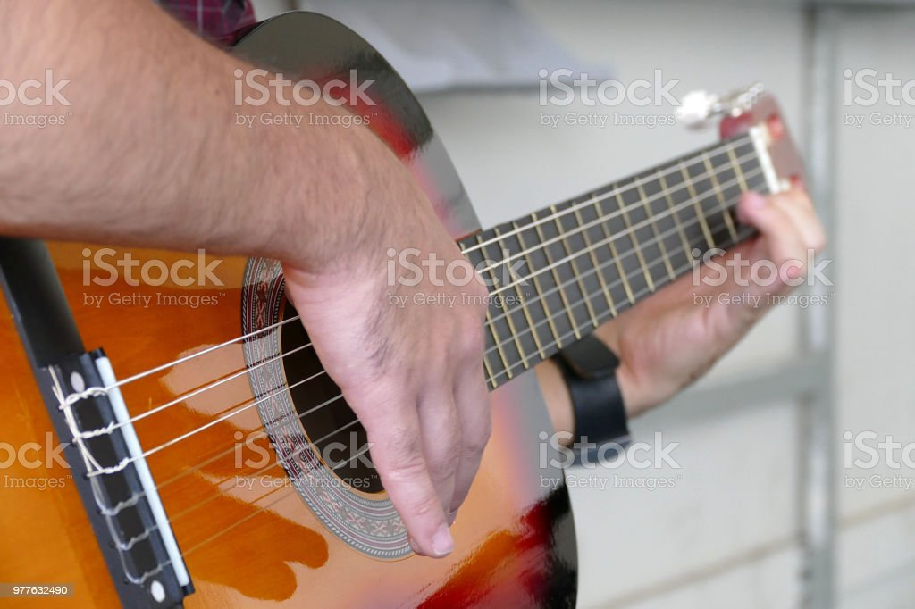 a musician plays a solo guitar, stock photo