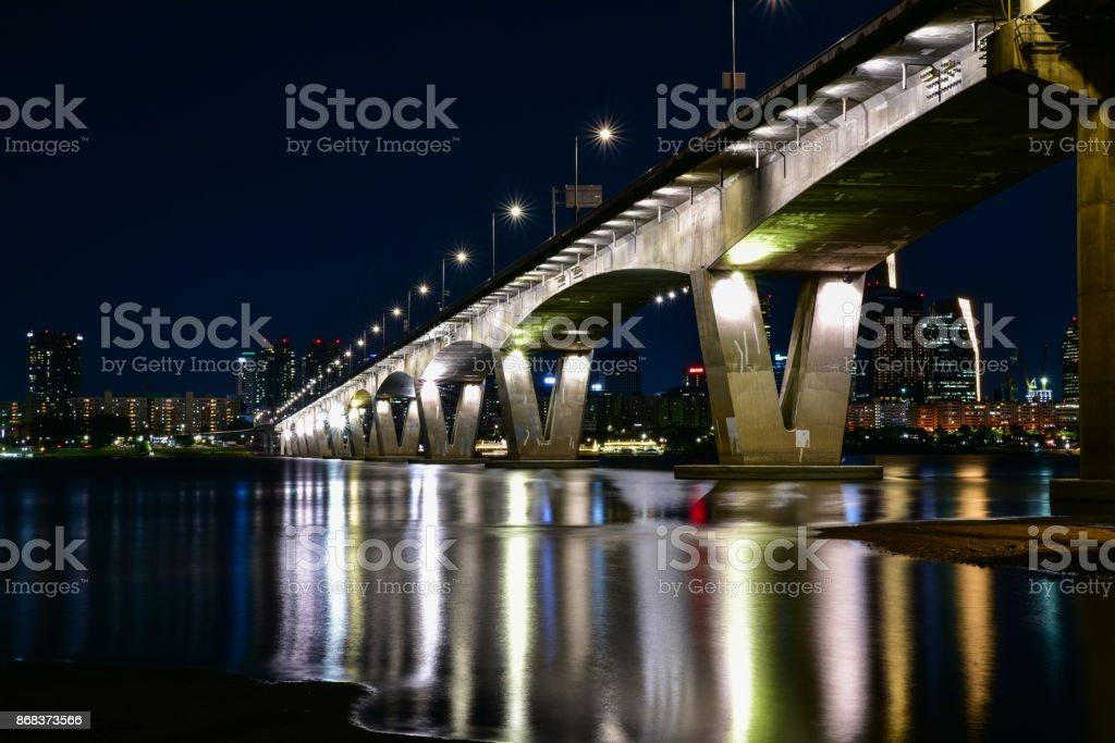 a night river bridge stock photo