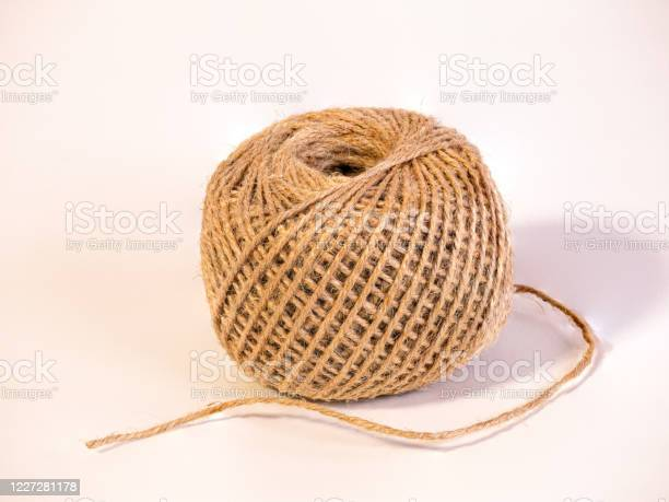 A partly uncoiled ball of string isolated on white background picture id1227281178?b=1&k=6&m=1227281178&s=612x612&h=m16y9asmhgxvsbbwro9 aietjfv0 jqamyv6kud06rk=