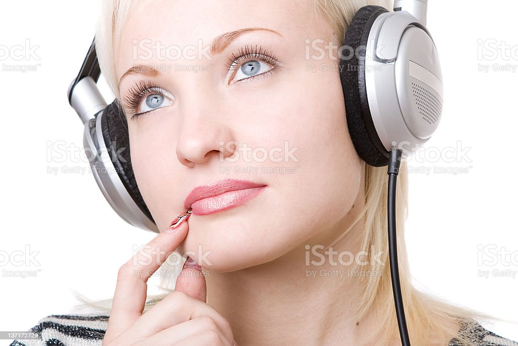 a pensive girl in headphones royalty-free stock photo