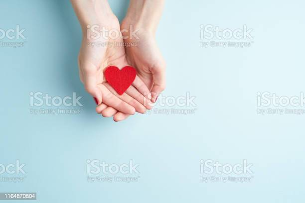 A person holding red heart in hands donate and family insurance on picture id1164870804?b=1&k=6&m=1164870804&s=612x612&h=vinehroshfntslajkgxcftuppsei6umtw4zdeyzg56w=