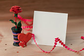 istock a piece of paper for the messa among the heart and roses of plasticine on a wooden table