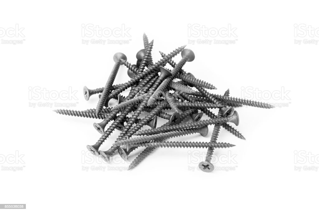 a pile of black screws isolated on white background stock photo
