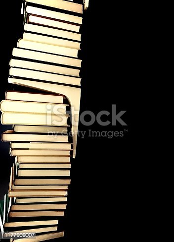 a pile of books in a row