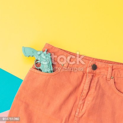 640200626istockphoto a plastic gun in the pocket 914751280