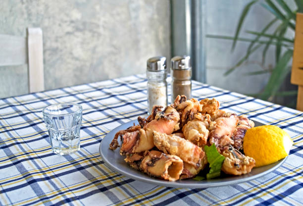 a plate with squid in a greek tavern - greek mediterranean seafood stock photo