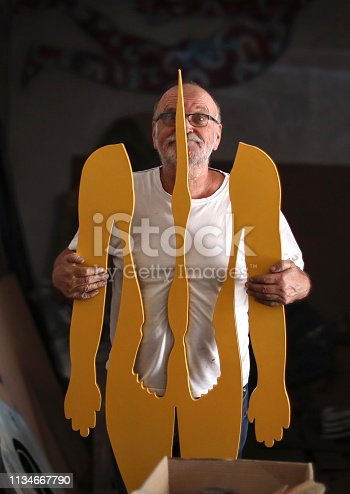 517780131 istock photo a Portrait of a senior artist in his studio. 1134667790