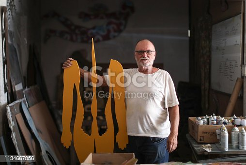 517780131 istock photo a Portrait of a senior artist in his studio. 1134667856