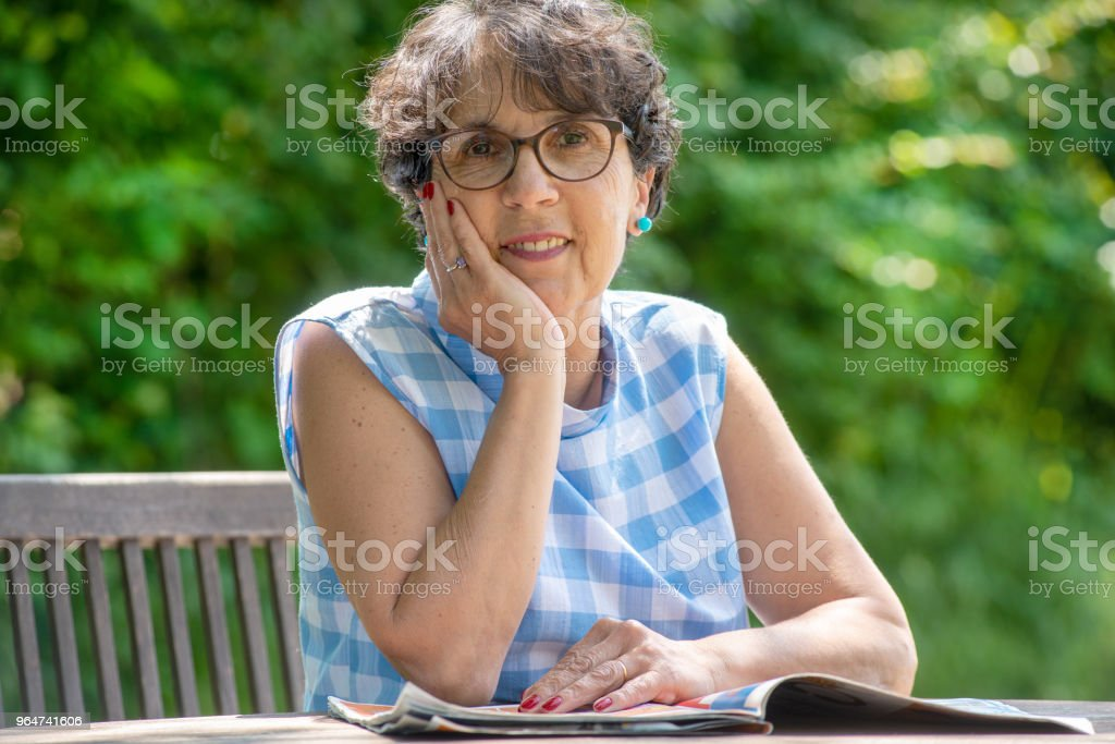 a portrait of mature brunette in the garden royalty-free stock photo