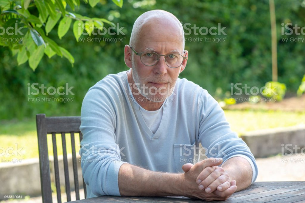 a portrait of senior man with glasses, outdoors zbiór zdjęć royalty-free