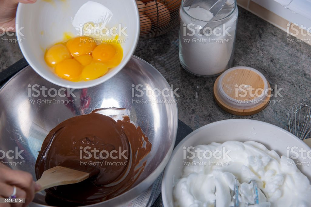 a preparation of chocolate mousse with eggs royalty-free stock photo