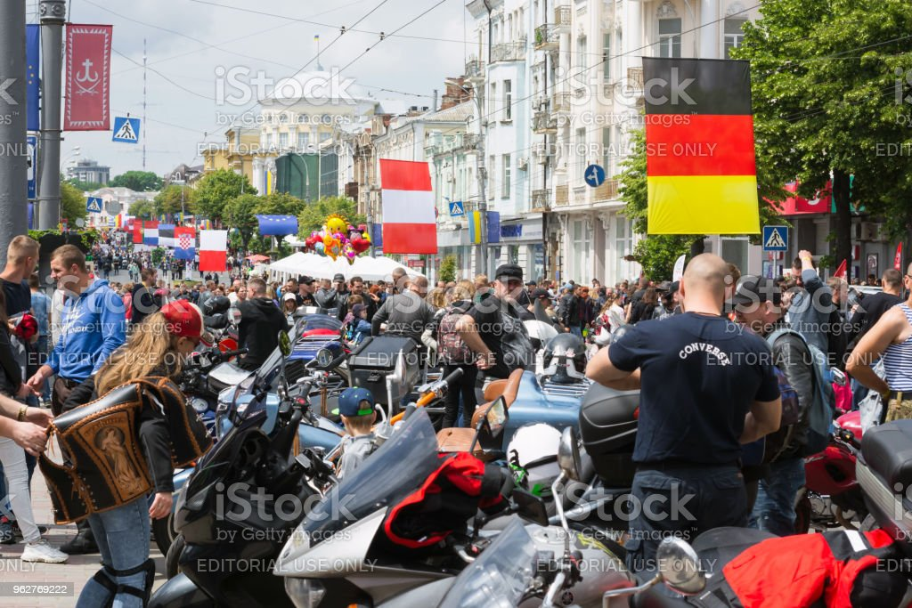 a rally of bikers for the celebration of Europe Day and people looking at what is happening - Foto stock royalty-free di Abbigliamento
