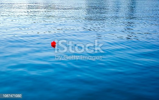 a red floating ball in the sea