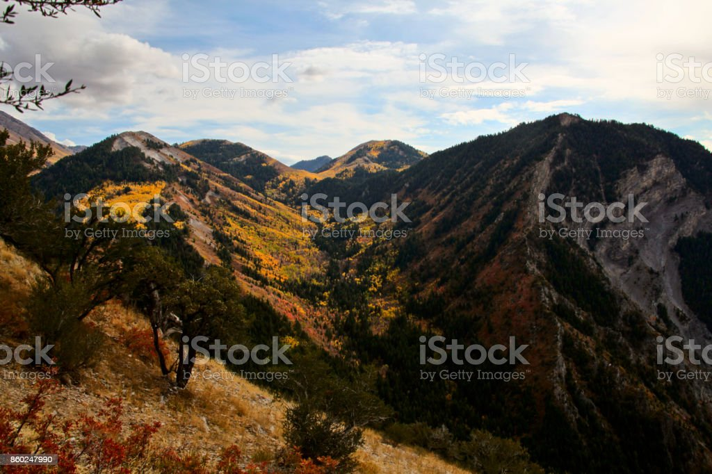 a remote mountain peak covered in fall foliage stock photo