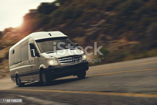 a rent bus is drive by highway