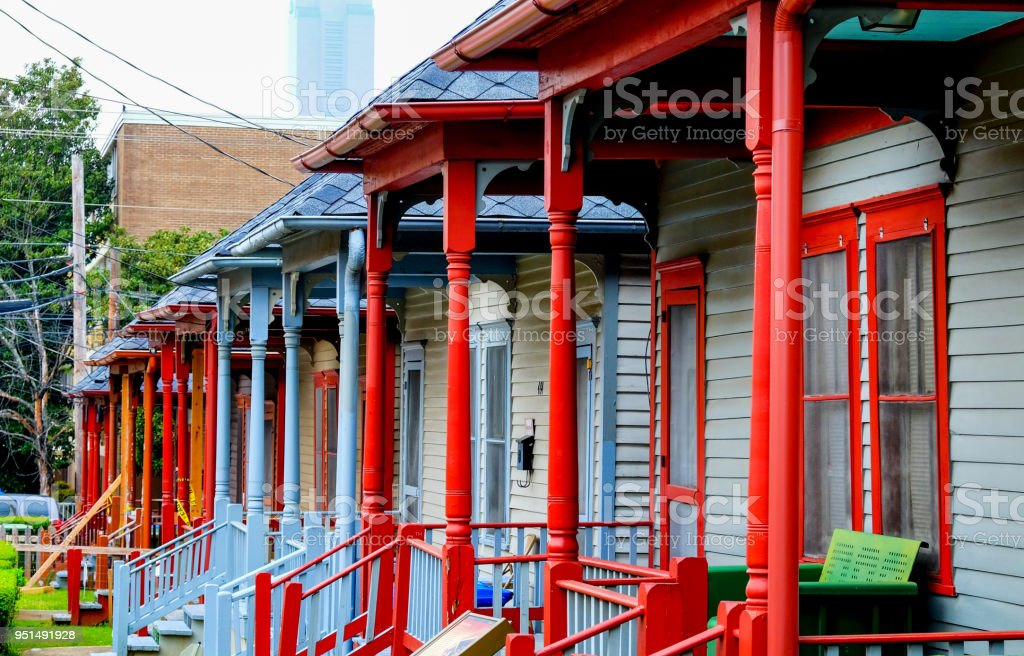 a Row of colorful porches on wooden houses stock photo