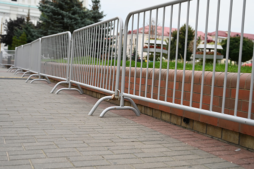 a row of metal barriers. High quality photo