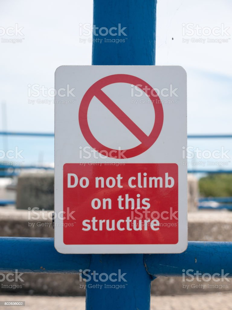 a safety no climbing sign outside on metal structure stock photo