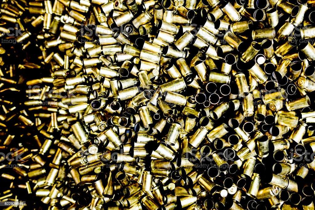 a sea of cartridge cases stock photo