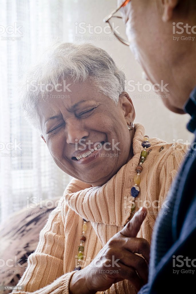 a senior couple laughing at home royalty-free stock photo