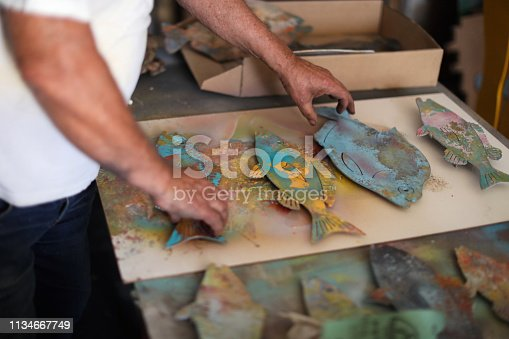 517780131 istock photo a Senior man creating sculptures in his art studio 1134667749
