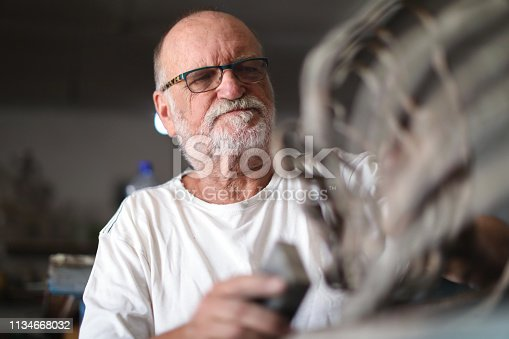517780131 istock photo a Senior man creating sculptures in his art studio 1134668032