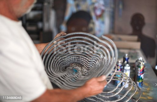 517780131 istock photo a Senior man creating sculptures in his art studio 1134668045